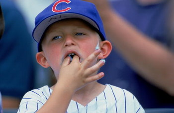 20 Jul 2000:  A young fan of the Chicago Cubs eats cotton candy during the game against the Philadelphia Phillies at Wrigley Field in Chicago, Illinois.  The Phillies defeated the Cubs 3-2.Mandatory Credit: Jonathan Daniel  /Allsport