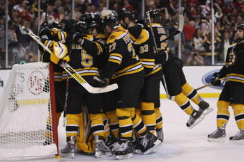 BOSTON - APRIL 19:  The Boston Bruins celebrate a win over the Montreal Canadiens during game six of the 2008 NHL Stanley Cup Playoffs Eastern Conference Quarterfinals series on April 19, 2008 at the TD Banknorth Garden in Boston, Massachusetts. The Bruin