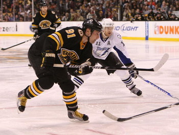 BOSTON - MARCH 31: Marc Savard #91 of the Boston Bruins skates against the Tampa Bay Lightning on March 31, 2009 at the TD Banknorth Garden in Boston. (Photo by Bruce Bennett/Getty Images)