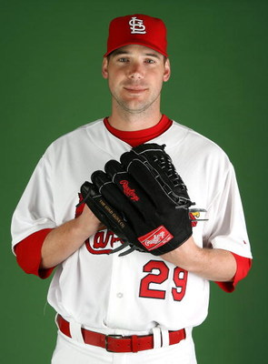 JUPITER, FL - FEBRUARY 20:  Pitcher Chris Carpenter #29 of the St. Louis Cardinals poses during photo day at Roger Dean Stadium on February 20, 2009 in Jupiter, Florida.  (Photo by Doug Benc/Getty Images)