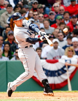 BOSTON - APRIL 9: Evan Longoria #3 of the Tampa Bay Rays hits a home run against the Boston Red Sox at Fenway Park April 9, 2009, in Boston, Massachusetts. (Photo by Jim Rogash/Getty Images)