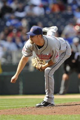 KANSAS CITY, MO - APRIL 15:  Kerry Wood of the Cleveland Indians, wearing a #42 jersey during the Jackie Robinson Day game throws a pitch in the ninth inning against the Kansas City Royals on April 15, 2009 at Kauffman Stadium in Kansas City, Missouri.  (