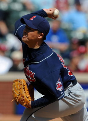 ARLINGTON, TX - APRIL 09:  Pitcher Masa Kobayashi #30 of the Cleveland Indians throws against the Texas Rangers on April 9, 2009 at Rangers Ballpark in Arlington, Texas.  (Photo by Ronald Martinez/Getty Images)
