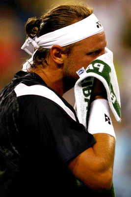 INDIAN WELLS, CA - MARCH 18:  David Nalbandian of Argentina towels off between points against Rafael Nadal of Spain during the BNP Paribas Open at the Indian Wells Tennis Garden March 18, 2009 in Indian Wells, California.  (Photo by Matthew Stockman/Getty