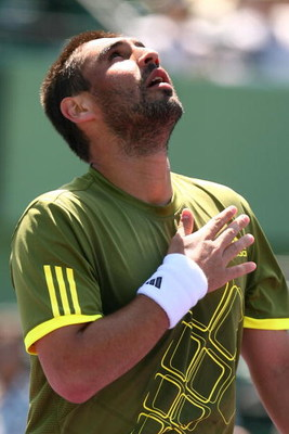 KEY BISCAYNE, FL - MARCH 25:  Marcus Baghdatis of Cyprus plays against Ernests Gulbis of Latvia during day three of the Sony Ericsson Open at The Crandon Park Tennis Center on March 25, 2009 in Key Biscayne, Florida.  (Photo by Al Bello/Getty Images)