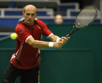ROTTERDAM, NETHERLANDS - FEBRUARY 11:  Nikolay Davydenko of Russia plays a backhand during his match against Julien Benneteau of France during day three of the ABN AMRO World Tennis Tournament at the Ahoy Centre Rotterdam on February 11, 2009 in Rotterdam