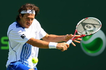 KEY BISCAYNE, FL - MARCH 25:  Tommy Haas of Germany returns a shot against Mikhail Kukushkin of Russia during day three of the Sony Ericsson Open at The Crandon Park Tennis Center on March 25, 2009 in Key Biscayne, Florida.  (Photo by Al Bello/Getty Image