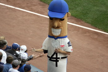 MILWAUKEE - JUNE 06: Racing Sausages The Hot Dog of the Milwaukee Brewers greets fand before the game against the Chicago Cubs on June 6, 2007 at Miller Park in Milwaukee, Wisconsin. The Cubs defeated the Brewers 6-2. (Photo by Jonathan Daniel/Getty Image