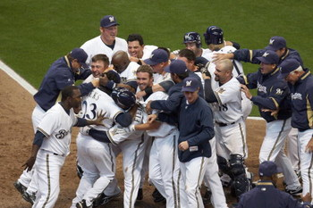MILWAUKEE - APRIL 10: Members of the Milwaukee Brewers mob teammate Rickie Weeks #23 after Weeks scored the winning run in the bottom of the 9th inning against the Chicago Cubs during the Opening Day game on April 10, 2009 at Miller Park in Milwaukee, Wis