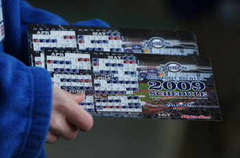 MILWAUKEE - APRIL 10: An usher prepares to hand out Milwaukee Brewers magnet schedules to fans arriving for the Opening Day game against the Chicago Cubs on April 10, 2009 at Miller Park in Milwaukee, Wisconsin. (Photo byJonathan Daniel/Getty Images)