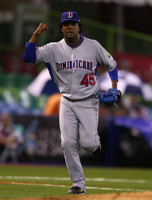 SAN JUAN, PUERTO RICO - MARCH 10:  Pedro Martinez #45 of The Dominican Republic celebrates getting out of the seventh inning against The Netherlands during the 2009 World Baseball Classic Pool D match on March 10, 2009 at Hiram Bithorn Stadium in San Juan