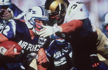 16 Sep 1995:  Quarterback Beau Morgan of the Air Force Falcons in action against Karl Ballard of the Colorado State Rams at Moby Arena in Fort Collins, Colorado.  Mandatory Credit: Mike Powell/Allsport