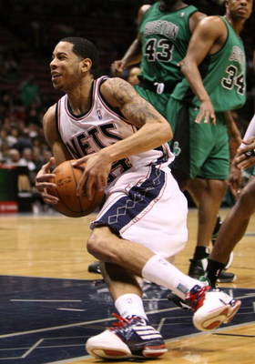 EAST RUTHERFORD, NJ - MARCH 04:  Devin Harris #34 of the New Jersey Nets slips with the ball against the Boston Celtics during their game on March 4, 2009 at The Izod Center in East Rutherford, New Jersey.  NOTE TO USER: User expressly acknowledges and ag