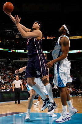 NEW ORLEANS - JANUARY 21:  Josh Boone #2 of the New Jersey Nets goes up for a shot against Melvin Ely #33 of the New Orleans Hornets on January 21, 2009 at the New Orleans Arena in New Orleans, Louisiana. The Hornets defeated the Nets 102-92.   NOTE TO US