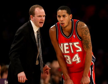 LOS ANGELES, CA - NOVEMBER 25:  Head coach Lawrence Frank and Devin Harris #34 of the New Jersey Nets confer during the game with the Los Angeles Lakers on November 25, 2008 at Staples Center in Los Angeles, California. The Lakers won 120-93.   NOTE TO US