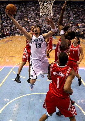 SALT LAKE CITY - APRIL 26:  Mehmet Okur #13 of the Utah Jazz lays up the ball against the Houston Rockets in Game Four of the Western Conference Quarterfinals during the 2008 NBA Playoffs at Energy Solutions Arena on April 26, 2008 in Salt Lake City, Utah