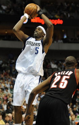 DALLAS - FEBRUARY 04:  Josh Howard #5 of the Dallas Mavericks takes a shot against Travis Outlaw #25 of the Portland Trail Blazers on February 4, 2009 at American Airlines Center in Dallas, Texas.  NOTE TO USER: User expressly acknowledges and agrees that