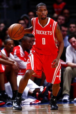NEW YORK - JANUARY 26:  Aaron Brooks #0 of the Houston Rockets drives against the New York Knicks on January 26, 2009 at Madison Square Garden in New York City.  NOTE TO USER: User expressly acknowledges and agrees that, by downloading and/or using this P