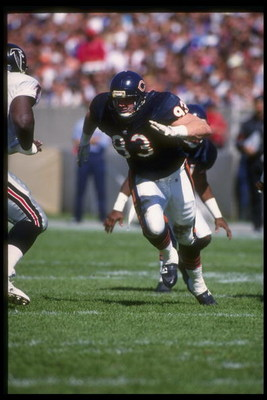 27 Sep 1992: Defensive lineman Trace Armstrong of the Chicago Bears (right) rushes the Atlanta Falcons line during a game at Soldier Field in Chicago, Illinois. The Bears won the game, 41-31.