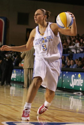 DENVER - FEBRUARY 18:  WNBA athlete Diana Taurasi handles the ball during the McDonald's NBA All-Star Celebrity Game at the Colorado Convention Center on February 18, 2005 in Denver, Colorado.  (Photo by Mark Mainz/Getty Images)