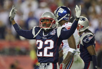 GLENDALE, AZ - FEBRUARY 03:  Cornerback Asante Samuel #22 of the New England Patriots celebrates after breaking-up a pass thrown to wide receiver Plaxico Burress #17 of the New York Giants (not pictured) in the third quarter during Super Bowl XLII on Febr