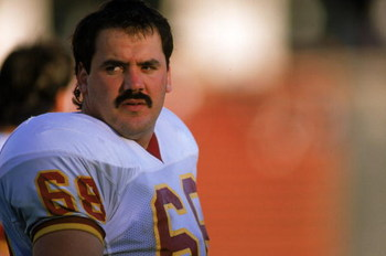 LOS ANGELES - OCTOBER 29:  Offensive linebacker Russ Grimm #68 of the Washington Redskins sits on the sideline during a game against the Los Angeles Raiders on October 29, 1989 at the Memorial Coliseum in Los Angeles, California. The Raiders won 37-24. (P