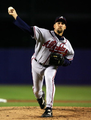 NEW YORK - SEPTEMBER 12:  John Smoltz #29 of the Atlanta Braves deals a pitch against the New York Mets during their game on September 12, 2007 at Shea Stadium in the Flushing neighborhood of the Queens borough of New York City.  (Photo by Jim McIsaac/Get