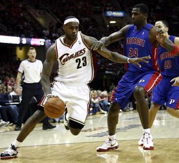 CLEVELAND - APRIL 18:  LeBron James #23 of the Cleveland Cavaliers dribbles by Antonio McDyess #24 of the Detroit Pistons during Game One of the Eastern Conference Quarterfinals during the 2009 NBA Playoffs at Quicken Loans Arena on April 18, 2009 in Clev