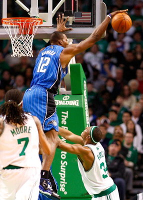 BOSTON, MA - MARCH 8: Dwight Howard #12 of the Orlando Magic blocks a shot by Paul Pierce #34 of the Boston Celtics at the TD Banknorth Garden on March 8, 2009 in Boston, Massachusetts. The Celtics lost 86-79. NOTE TO USER: User expressly acknowledges and