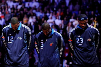 PHOENIX - FEBRUARY 15:  Dwight Howard #12, Dwyane Wade #3 and LeBron James #23 of the Eastern Conference stand during the National Anthem before the 58th NBA All-Star Game, part of 2009 NBA All-Star Weekend at US Airways Center on February 15, 2009 in Pho