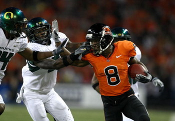 CORVALLIS, OR - NOVEMBER 29:  James Rodgers #8 of the Oregon State Beavers is tackled runs with the ball against Remene Alston Jr. #5 of the Oregon Ducks at Reser Stadium on November 29, 2008 in Corvalis, Oregon.  (Photo by Jonathan Ferrey/Getty Images)