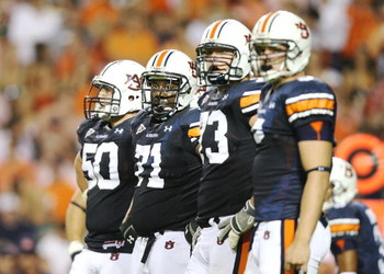 AUBURN, AL - SEPTEMBER 20:  Offensive lineman Ryan Pugh #50, Tyronne Green #71, Lee Ziemba #73 and tight end Tommy Trott #5 of the Auburn Tigers prepare for a play while taking on the LSU Tigers at Jordan-Hare Stadium on September 20, 2008 in Auburn, Alab