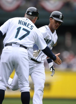 SEATTLE - APRIL 19:  Ronny Cedeno #3 of the Seattle Mariners is congratulated by third base coach Bruce Hines after hitting a solo home run in an 8-2 loss to the Detroit Tigers on April 19, 2009 at Safeco Field in Seattle, Washington. (Photo by Otto Greul