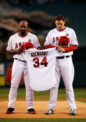 ANAHEIM, CA - APRIL 10: Torii Hunter #48 (L) and  pitcher John Lackey #41 (R) of the Los Angeles Angels hold teammate Nick Adenhart's jersey during a moment of silence before the start of the game against Boston Red Sox at Angel Stadium April 10, 2009 in