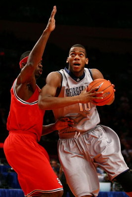 NEW YORK - MARCH 10:  Greg Monroe #10 of the Georgetown Hoyas goes to the hoop against Justin Burrell #24 of the St. John's Red Storm during the first round of the Big East Tournament at Madison Square Garden on March 10, 2009 in New York City.  (Photo by