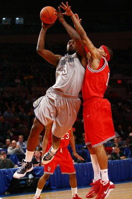 NEW YORK - MARCH 10:  DaJuan Summers #3 of the Georgetown Hoyas goes to the hoop against D.J. Kennedy #1 of the St. John's Red Storm during the first round of the Big East Tournament at Madison Square Garden on March 10, 2009 in New York City.  (Photo by