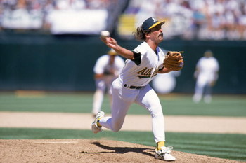 OAKLAND, CA - JULY 4:  Pitcher Dennis Eckersley #43 of the Oakland Athletics delivers against the Milwaukee Brewers during the game at the Oakland-Alameda County Coliseum on July 4, 1995 in Oakland, California.  The Athletics won 5-3.  (Photo by Jed Jacob