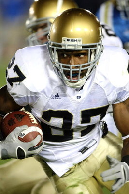 PASADENA, CA - OCTOBER 6:  Safety David Bruton #27 of the Notre Dame Fighting Irish returns an interception against the UCLA Bruins on October 6, 2007 at the Rose Bowl in Pasadena, California.   Notre Dame won 20-6. (Photo by Stephen Dunn/Getty Images)
