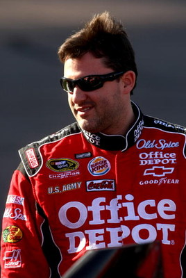 AVONDALE, AZ - APRIL 17:  Tony Stewart, driver of the #14 Office Depot/Old Spice Chevrolet, waits by his car during qualifying for the NASCAR Sprint Cup Series SUBWAY Fresh Fit 500 at Phoenix International Raceway on April 17, 2009 in Avondale, AZ.  (Phot