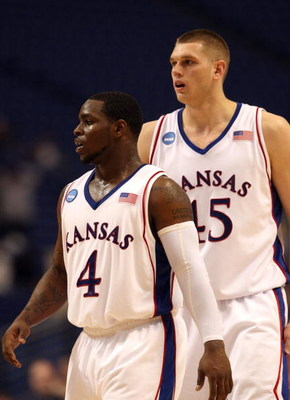 MINNEAPOLIS - MARCH 20:  (L-R) Sherron Collins #4 and Cole Aldrich #45 of the Kansas Jayhawks look on against the North Dakota State Bison during the first round of the NCAA Division I Men's Basketball Tournament at the Hubert H. Humphrey Metrodome on Mar