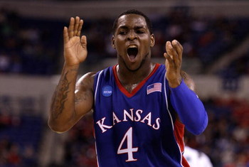 INDIANAPOLIS - MARCH 27:  Sherron Collins #4 of the Kansas Jayhawks reacts in the first half against the Michigan State Spartans during the third round of the NCAA Division I Men's Basketball Tournament at the Lucas Oil Stadium on March 27, 2009 in Indian