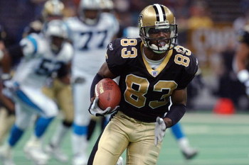 NEW ORLEANS, LA - DECEMBER 29:  Wide receiver Donte Stallworth #83 of the New Orleans Saints carries the ball against the Carolina Panthers during the NFL game at the Louisiana Superdome on December 29, 2002 in New Orleans, Louisiana. The Panthers beat th