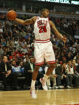 CHICAGO - MARCH 24: Tyrus Thomas #24 of the Chicago Bulls grabs a rebound against the Detroit Pistons on March 24, 2009 at the United Center in Chicago, Illinois. The Bulls defeated the Pistons 99-91. NOTE TO USER: User expressly acknowledges and agreees
