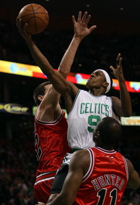 BOSTON - APRIL 20:  Rajon Rondo #9 of the Boston Celtics is fouled by Brad Miller #52 of the Chicago Bulls in Game Two of the Eastern Conference Quarterfinals during the 2009 NBA Playoffs at TD Banknorth Garden on April 20, 2009 in Boston, Massachusetts.