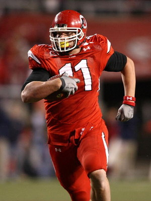 SALT LAKE CITY - NOVEMBER 22:  Paul Kruger #11  of the Utah Utes returns an interception against the BYU Cougarsat Rice-Eccles Stadium on November 22, 2008 in Salt Lake City, Utah.  (Photo by Jonathan Ferrey/Getty Images)