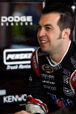 AVONDALE, AZ - APRIL 17:  Sam Hornish Jr., dirver of the #77 Mobil 1 Dodge, talks with crewmembers during practice for the NASCAR Sprint Cup Series SUBWAY Fresh Fit 500 at Phoenix International Raceway on April 17, 2009 in Avondale, AZ.  (Photo by Chris G