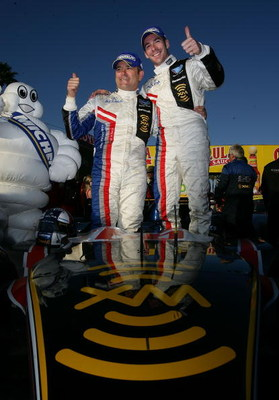 LONG BEACH, CA - APRIL 18:  Simon Pagenaud (R} and Gil de Ferran {L}drivers of the #66 de Ferran Motorsports LMP1 Acura ARX -01B celebrate winning the Tequila Patron American Le Mans Series at Long Beach on April 18, 2009 on the streets of Long Beach, Cal