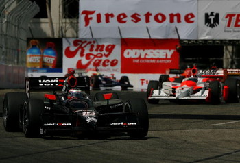 LONG BEACH, CA - APRIL 19:  Will Power drives the #12 Verizon Team Penske Dallara Honda ahead of Helio Castroneves in the #3 Team Penske Dallara Honda during the IRL IndyCar Series Toyota Grand Prix of Long Beach on April 19, 2009 on the streets of Long B