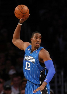 LOS ANGELES - JANUARY 16:  Dwight Howard #12 of the Orlando Magic looks to make a play to the basket during their NBA game against the Los Angeles Lakers on January 16, 2009 at Staples Center in Los Angeles, California. The Magic won 109-103.   NOTE TO US