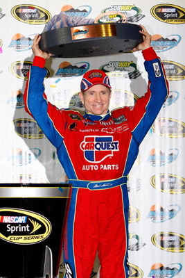 AVONDALE, AZ - APRIL 18: Mark Martin, driver of the #5 CARQUEST/Kellogg's Chevrolet, celebrates in victory lane after winning the NASCAR Sprint Cup Series SUBWAY Fresh Fit 500 at Phoenix International Raceway on April 18, 2009 in Avondale, AZ.  (Photo by